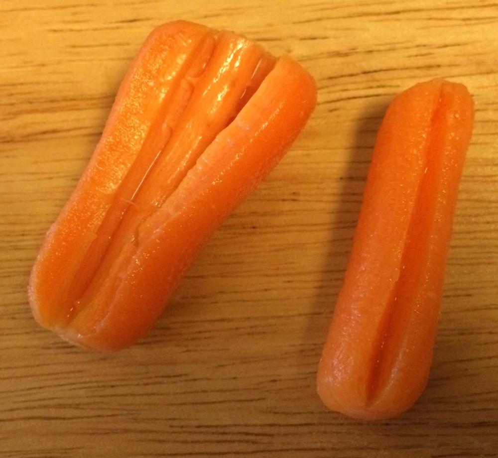 Baby carrots that split open, revealing the xylem inside.