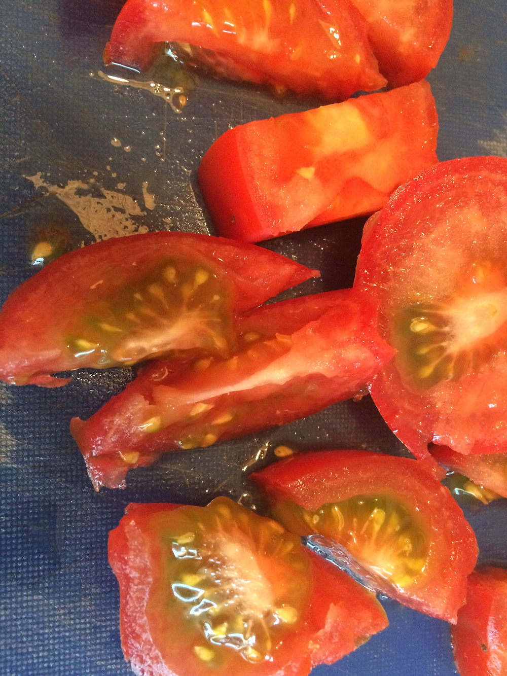 There's a green tinge to the insides of these tomatoes, but that's most likely genetics