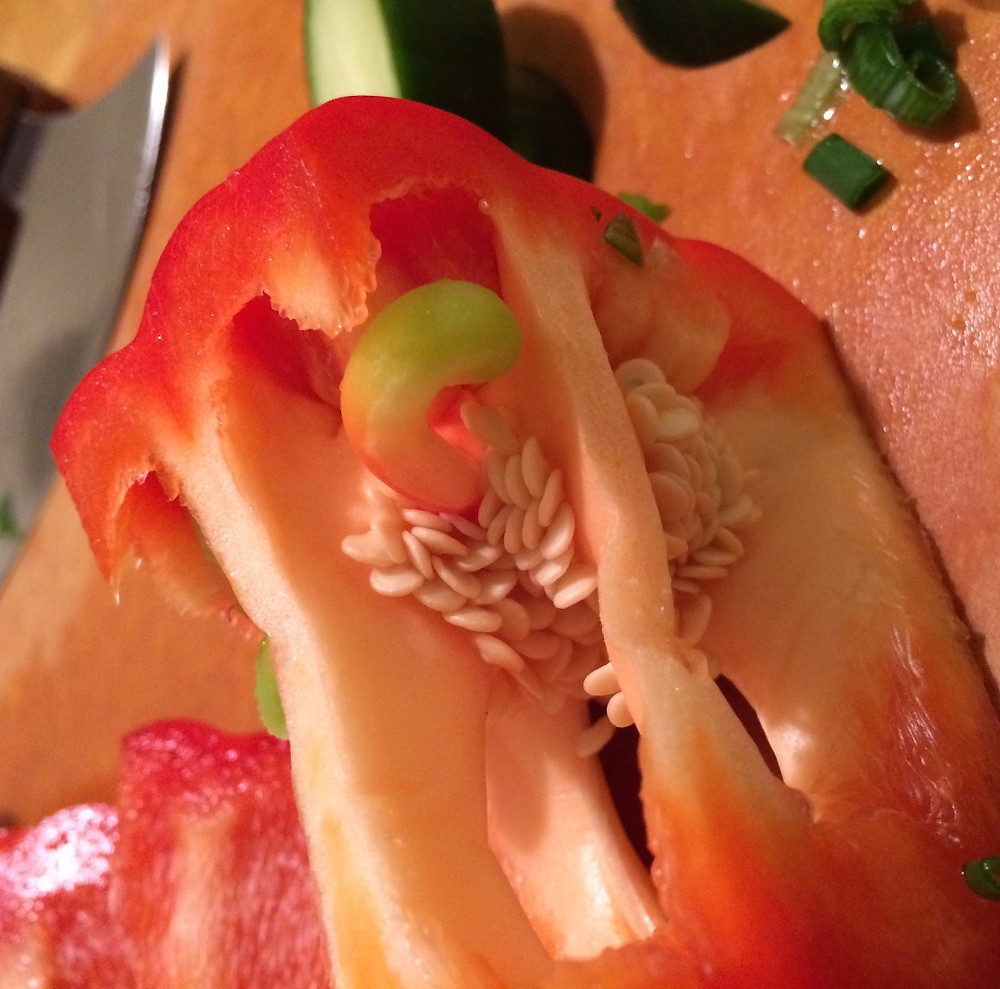 A missed cue in this red pepper's reproduction caused it to grow this worm-shaped pepper tissue inside.