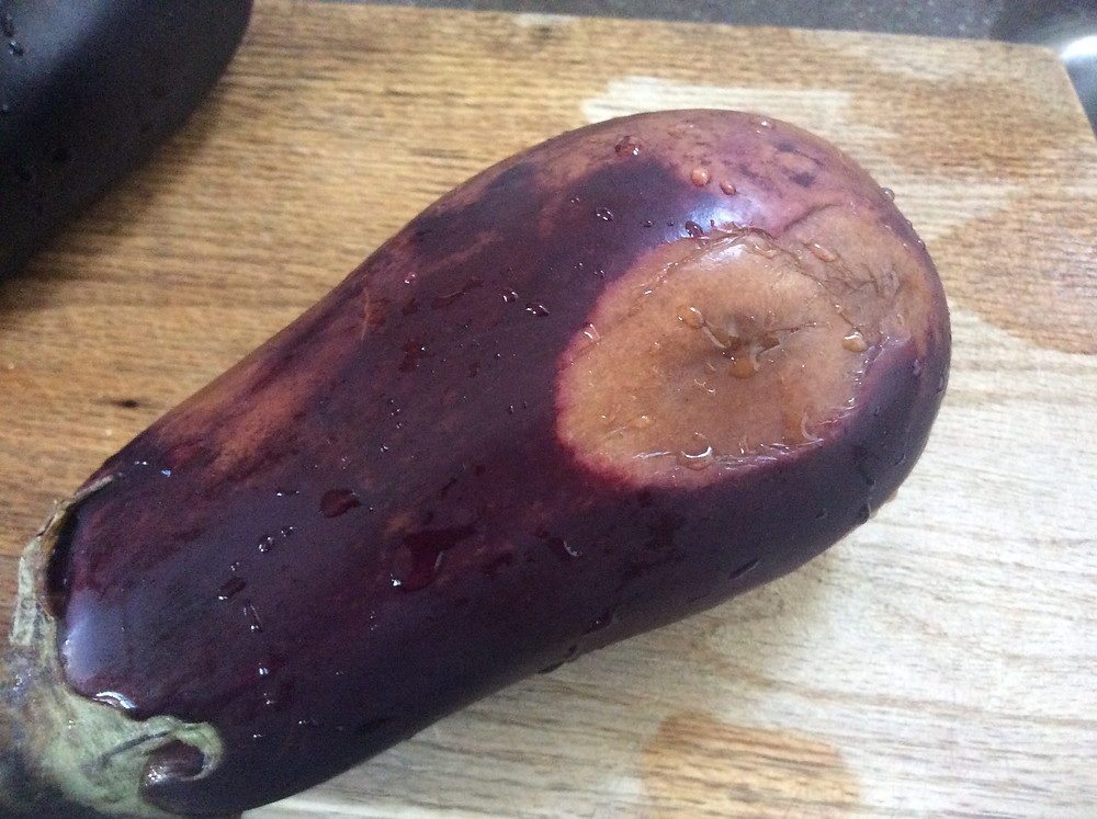 The orange, wet lesion on this eggplant means it's not worth eating; but if you see smaller orange spots, they're just damage from cold and don't make your food unsafe.