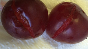 Cracked open plums