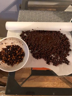 Rolling roasted chickpeas in choclate