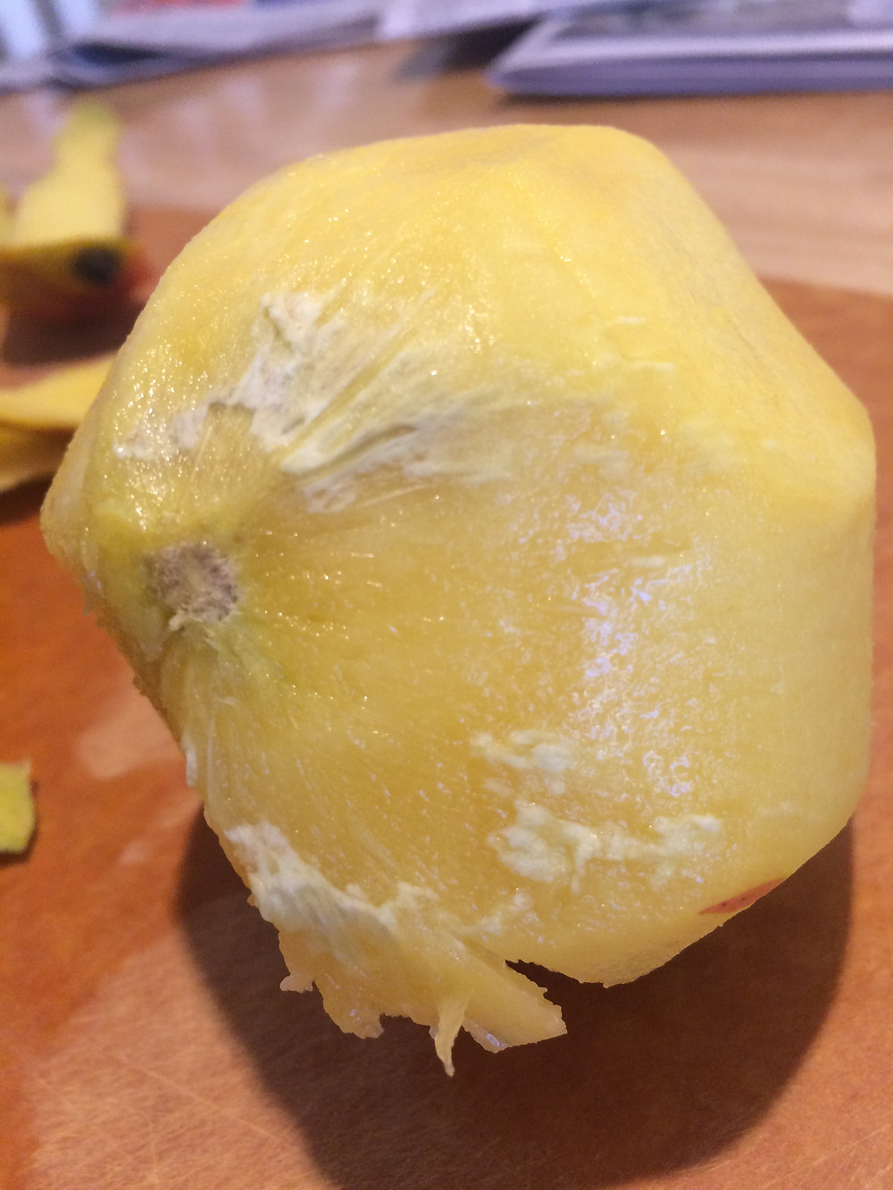 "White stuff just under a mango's peel is probably superficial ""scald""; the mango is still fine to eat"
