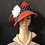 Thumbnail: Flame red straw cloche with navy and white polkadot