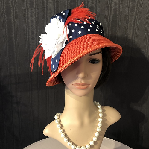Flame red straw cloche with navy and white polkadot