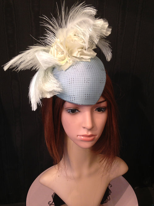 Turquoise silk fascinator with net