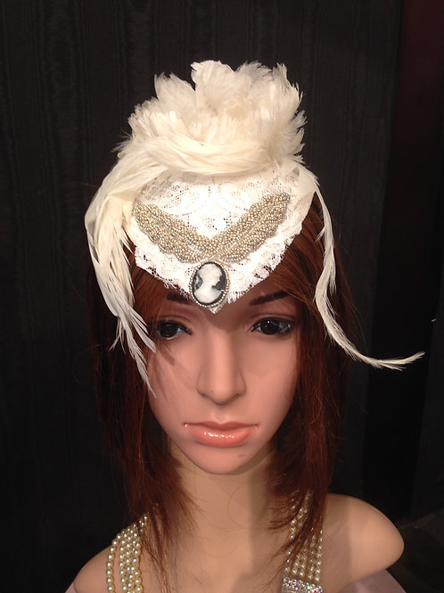 Ivory sinamay fascinator with cameo