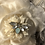 Thumbnail: Winter white felt small Tiffany with bee broach