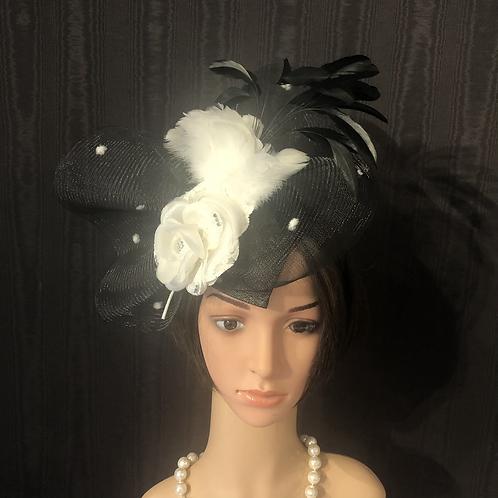 Black with white polkadots crinoline fascinator