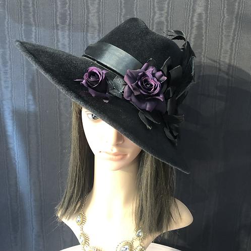 Black fur felt Garbo with purple roses