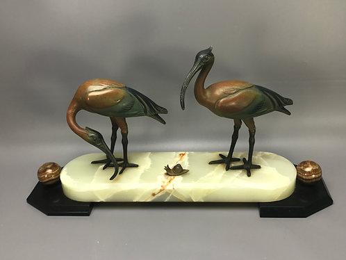 Ibis vogels met slak (BIEDEN VANAF)