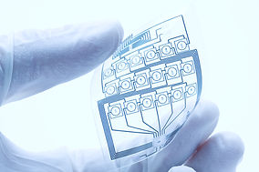 Laser processing for curved material and flexible electronics