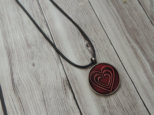 Red heart metal pendant on Necklace