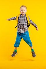 boy-jumping-yellow-wall.jpg