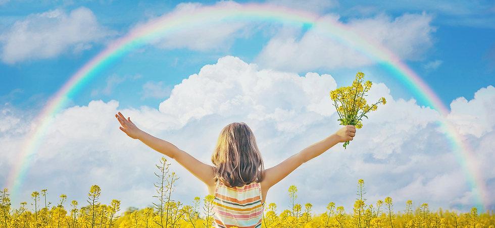child-yellow-rainbow-field.jpg