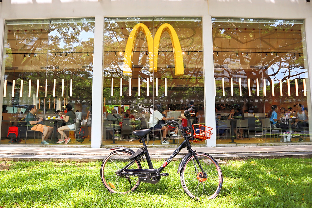 Mcdonalds with an SG Bike parked in front