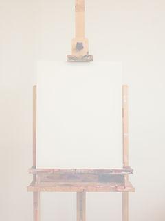 Canvas%20on%20an%20easel%20in%20art%20studio._edited.jpg