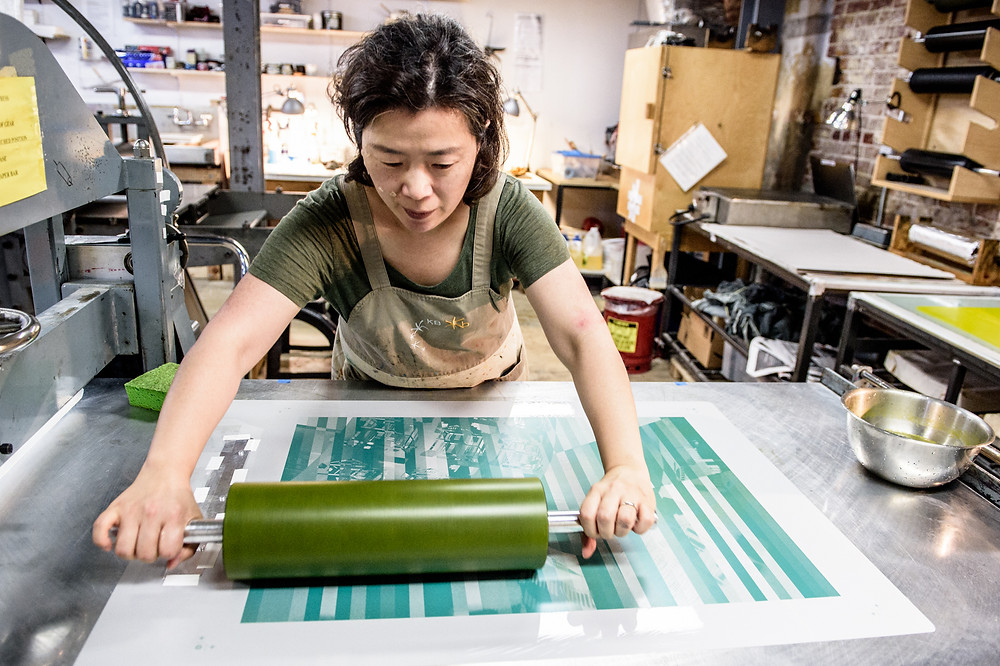 Former Denbo Fellow Sang-Mi Yoo at work in the Print Shop.
