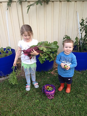 Children showing off the food they grew