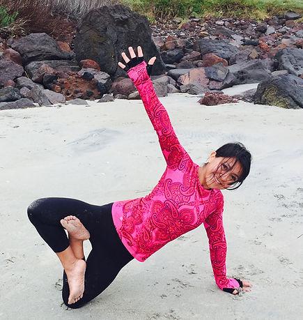 Yoga Instructor posing on beach