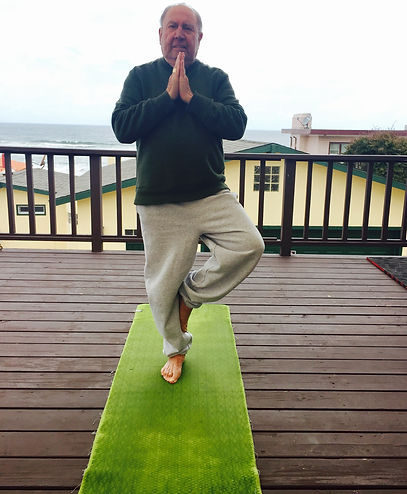 Yoga posing on deck with ocean view