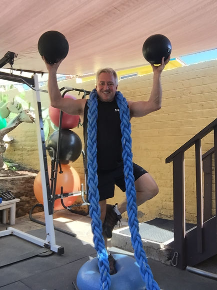 Personal Trainer showing off exercise equipment