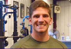 Smiling young strength coach