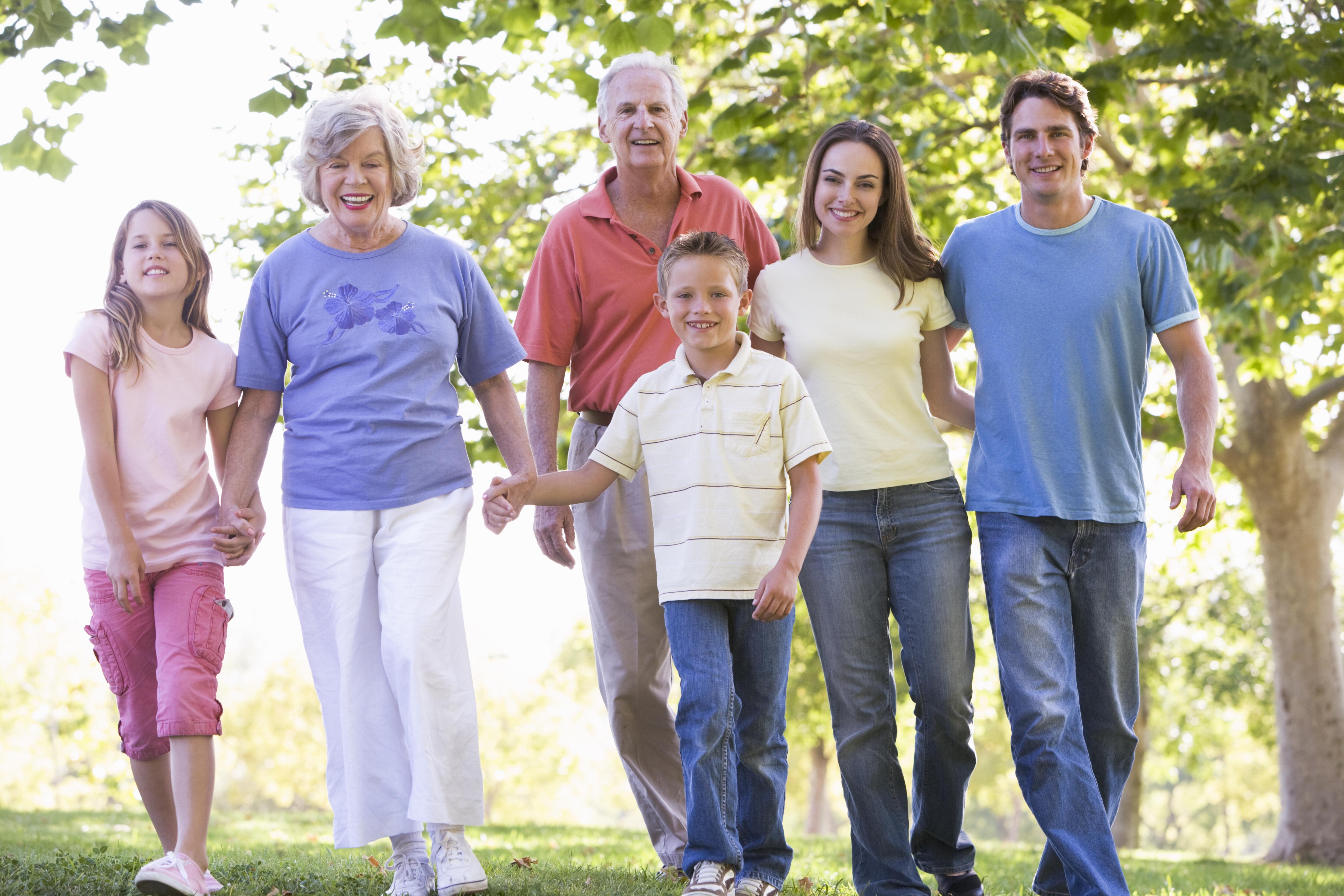 extended-family-walking-in-park-holding-