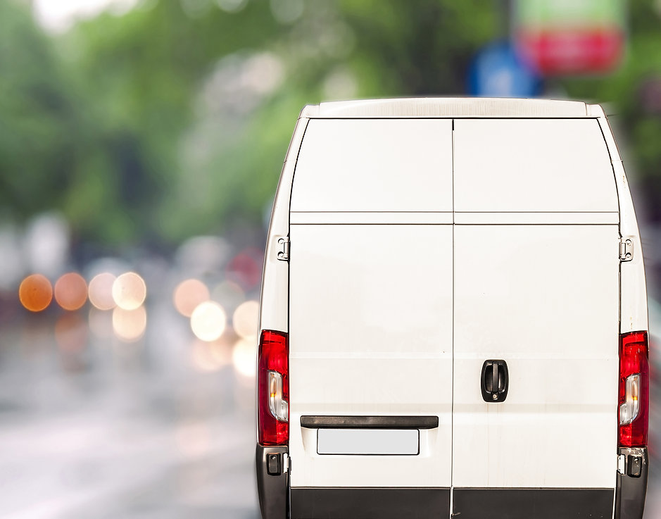 White delivery Van driving fast on city
