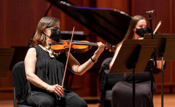 Mary Beth Harrison (violin) and Linda Pyle (violin)  Photo Credit: Seattle Symphony / James Holt; Benaroya Hall