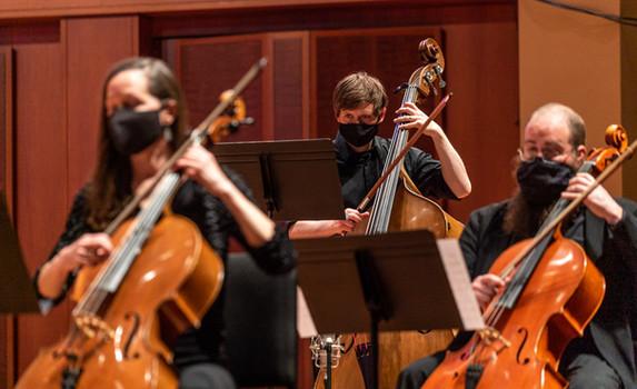 Holly Reeves (cello), Nick Masters (bass), and Joe Sokolik (cello)  Photo Credit: Seattle Symphony / James Holt; Benaroya Hall