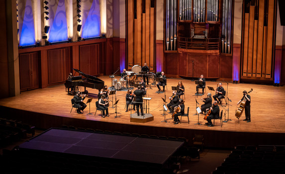 """Ensemble of OSO musicians performing Variations of """"Pastures of Plenty"""", an educational initiative in partnership with Emerald City Music and Tumwater School District/Tumwater Hill Elementary  Photo Credit: Seattle Symphony / James Holt; Benaroya Hall"""