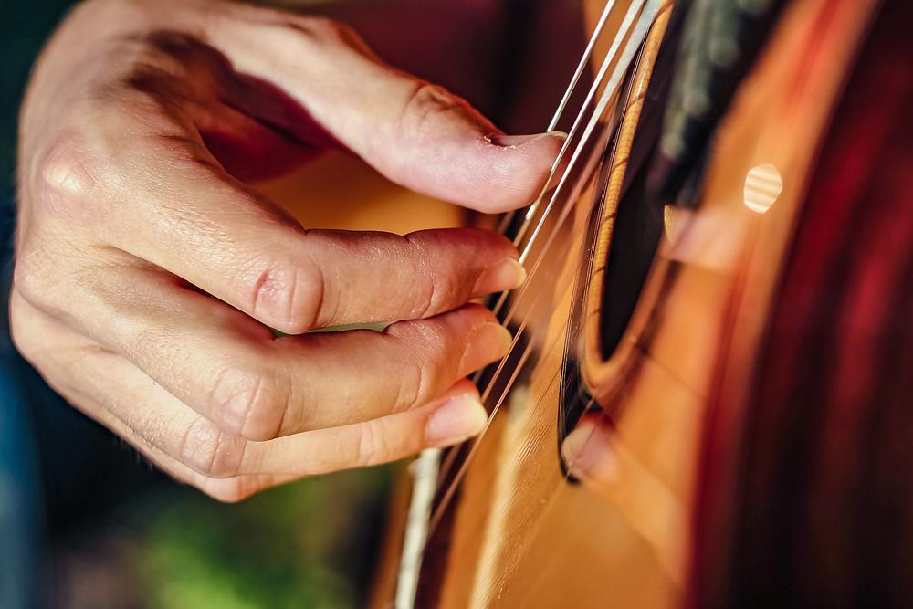 Guitarist playing classical guitar