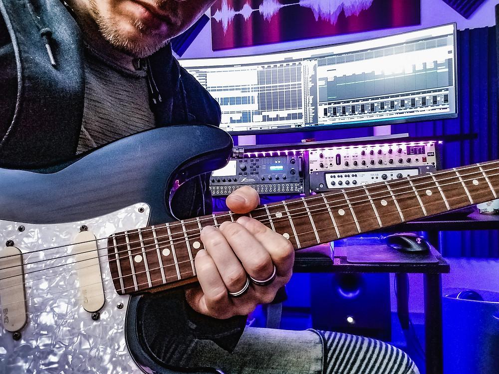 A Remote Session Guitarist in His Studio