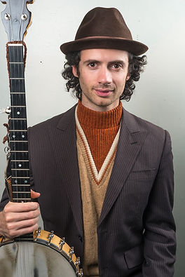 Man with a banjo in a suit