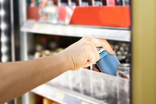 woman-getting-can-convenience-store-with