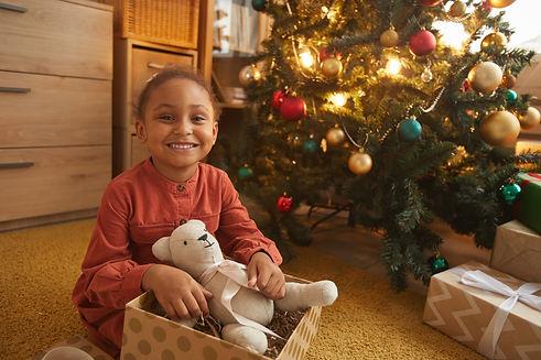 african-american-girl-opening-christmas-