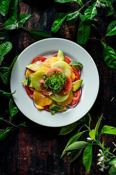 citrus carpaccio salad based on seasonal fruits and vegetables