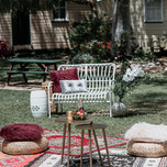 Boho picnic chillout area with cane lounges