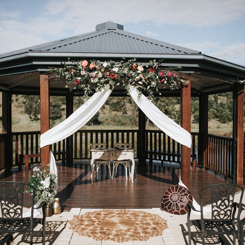 Large floral installation with drape