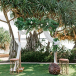 Rustic timber arbour with greenery