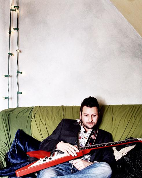 Joel with a guitar. Copyright Sarah Curtice Photography