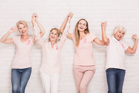 Group of happy women winning the struggle with breast cancer.jpg