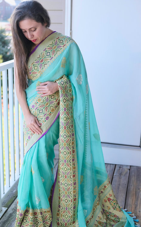 Exclusive Georgette Banarasi Saree in Turquoise, Silver and Gold