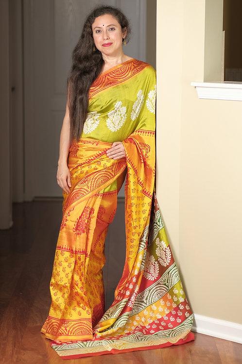 Pure Hand Printed Bishnupuri Katan Silk Saree in Orange and Green