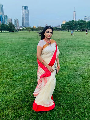 Debarna from New Jersey wearing a Bengal Cotton Tant Saree with Ganga Jamuna Border in Off White, Red and Brown from Bengal Looms