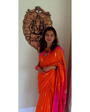 Sandhya from New Jersey decked in a Linen Saree in Orange from Bengal Looms