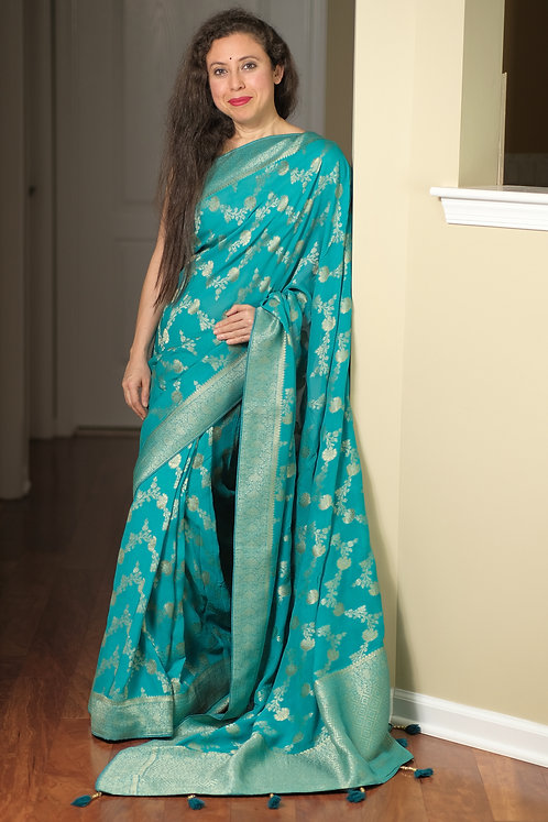 Pure Crepe Georgette Jaal Work Banarasi Saree in Turquoise and Gold