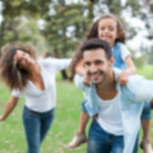A father and mother are spending quality time with their child after improving their parenting with a parent coaching session from Simply Psychology in Phoenix and Scottsdale, Arizona.