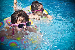 Two children enjoy the summer in Phoenix after being tested for anxiety disorders, OCD, Tourette Syndrome, and Autism at Simply Psychology.